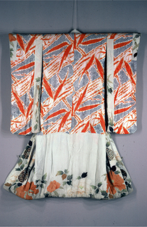 Under kimono with very long sleeves of silks in red and blue with tied-resist patterns, with a wide border of crepe painted with a leaf and flower design. Double border at bottom and along collar. Lined with red silk.