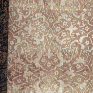 Large panel of undyed, loosely woven cotton cloth block printed in gold with and all-over pattern of tangent roundels with griffon-like creatures facing left and right in alternation. Border of another Fortuny print of scrolling vine and leaf forms in gold on a dark blue ground. Faced with loosely woven undyed cotton cloth.