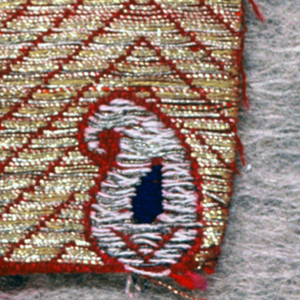 Small stylized blue and white cone repeat on gold and red herringbone ground.