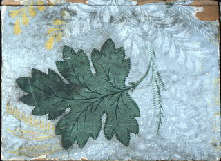 "Box covered with wallpaper: Green, white and yellow foliage on gray. Lined with newspaper, ""Daily Patriot"" of Concord, NH, dated January 1855."