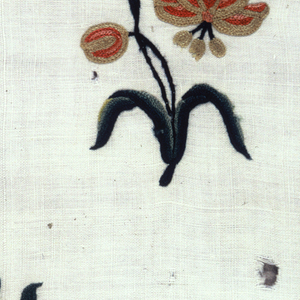 Section of undyed cloth embroidered with medium-scale stylzied semi-fantastic flower sprays with graceful S-curve, in wool chain stitch in shades of pink, blue, green, yellow, white; horizontal rows, diagonal repeat. One plain selvage.