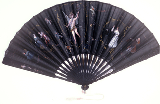 Pleated folding fan with a black silk gauze leaf, painted with Cupid in a heart-shaped framework at center, surrounded by figures in costumes from various periods and locations. Black carved and painted sticks.