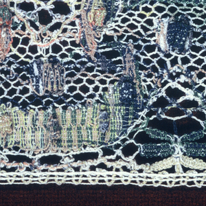 Multicolored border lace in a serpentine pattern.