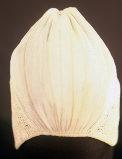Child's cap of white linen. The broad brim is pierced and embroidered in a small all-over floral design in white, primarily in buttonhole stitch. The crown of the cap is of fine cotton dimity, shirred into extremely fine pleats. Bound with plain braid. At lower corners, inside, two loops of twisted thread indicate place for ties.