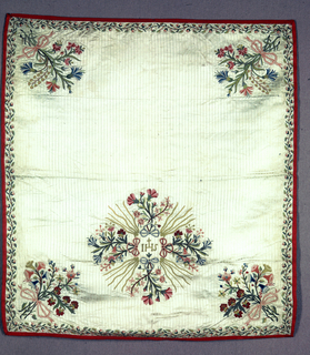 Cream satin ground with vertical pencil stripes of weft floats, embroidered in bright pastels with bouquets tied with ribbon bow in four corners. Holy monogram surrounded by rays and flower sprays, lower center. Piped with bright pink ribbed silk lined with strie silk cloth of period.