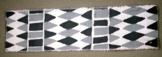 Small-scale repeat of close-set rows of diamonds alternating with rows of squares and triangles. In two shades of gray on a white ground.