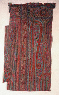 Section of shawl with long rectangular compartments filled with long intertwining cones, floral guard borders and a long strip with repeat of small cones. T-shaped seam in the middle, extremely skillful minor seams crossed by embroidery. Multicolored wools on fine black wool twill ground.