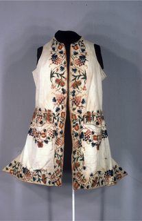 Gentleman's embroidered waistcoat with embroidered decoration of fruits and vines at center front bottom and pocket area.