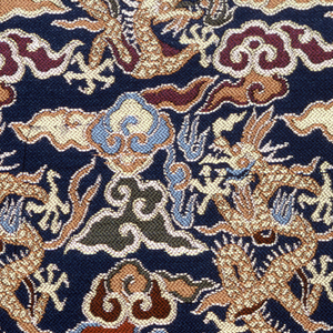 Irregular piece of woven silk with a small-scale design of dragons and cloud bands, in subtle shades of dark red, rust, gold, beige, green and blue on a dark blue ground. Fine chevron twill weave.