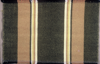 Stole end with warp fringe. Warp stripes of various widths in black, dark brown, beige, and yellow; yellow weft.