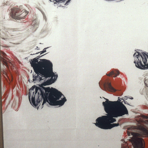 Big bold brushed roses in pure-shades and mingling of red, grey-green, black; widely spaced on white ground.