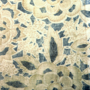 Flat all-over design of large compound flower-heads and various small leaves in golden tan, white, and blue on blue ground. Breadth with two plain selvedges.