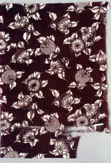 Design of scattered fruits in white showing crackle of paste reserve on a dark purple ground.