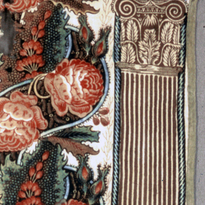 Fragment, probably from a curtain, of cream-colored cotton, block printed in a pillar design. Bands of twining rose vines against a leaf pattern in blues and browns with touches of yellow, now faded, alternate with a pillar in narrow brown stripes. Fragment is full width with blue thread selvages.
