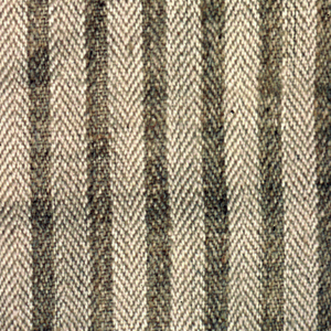 Two shades of undyed linen woven in a warp chevron twill in a design showing brown stripes on a buff ground.