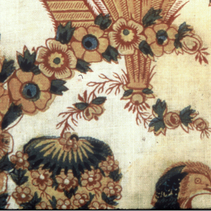 Coarse white cotton, slightly glazed. Printed in dull red, buff, green, blue, violet, brown and drab. Fantastic design showing flower basket with long-tailed bird above. Irregular arch extends from the flowers. Under the arch, pointing at the bird, stands a man in Chinoiserie-style dress which a pointed hat and cane.