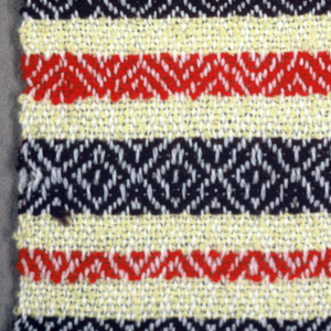 Loosely-woven yellow ground with wide and narrow bands of diamond twill weave in scarlet or dark brown. Pale lavender warps. Warp fringe knotted to form tassels.