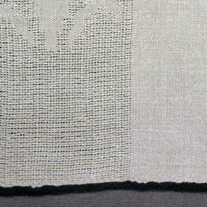 Beige-colored table mat with a closely-woven center section with two bands of gauze weave on either end.