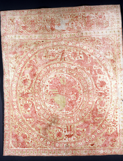 White cotton quilted in yellow silk and embroidered in red silk back stitch. Main design is a large circle with inner circles; inner circle contains the pious pelican; outer circle has paired winged gryphons with a man holding tails; guard border. Corner, crowned double-headed eagle. At side, horizontal border, confronted mermaids playing flutes. Portuguese design showing Indian influence.
