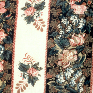 Printed in vertical stripes of thickly clustered polychrome flowers on black ground. Between black stripes are narrow stripes with widely-spaced flower clusters printed on white ground. Two selvages with three blue threads.