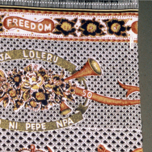 Printed cotton with a large oval medallion containing a portrait of Prince A.Oyekan dated 1950. Above the medallion, two putti hold a crown. Surrounding the medallion are floral garlands and banners reading Labour, Market, Demo and Freedom. Scattered over the imbricated black and white ground are crowns, caps of office, crossed spears, and bags of money. Borders top and bottom with floral garlands and banners reading Labor, Freedom, and Demo.