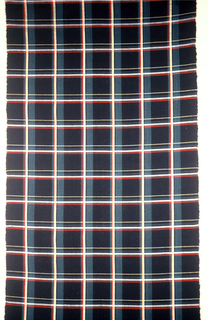 Large plaid pattern predominantly black and green with red and yellow.