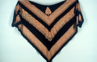 Large square of fine black wool made to be folded diagonally to show three wide borders of solidly embroidered multicolored cone patterns.