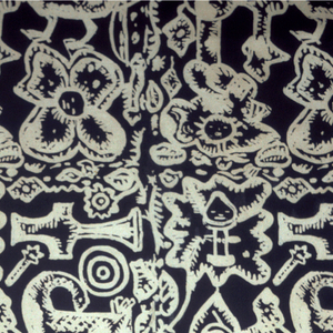 Length of cloth resist printed in an allover with the pattern reserved in white shows a large bird looking back, a cross, a big rosette, etc. Cloth is cut off at either side in the middle of the pattern, which also extends over the edges. Mary Kirby, teacher of crafts in Ghana in the 1950-early 1960s, thinks that this is not original Asante work, but student work from a Ghana school.