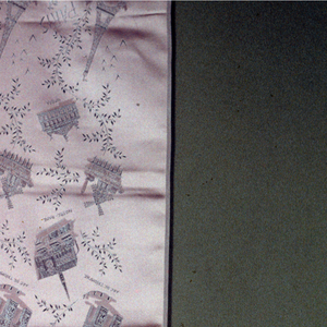 Satin scarf with a woven pattern of various Paris buildings.