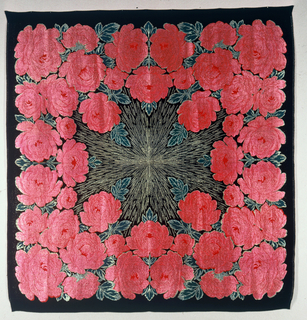 Square of black ribbed silk shot through solidly with gold thread secured in twill and satin weave. Printed in red and green in a pattern of huge rose wreath around a central sunburst of gold.