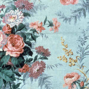 Thin, highly glazed chintz with a background of pale grey-blue showing large clusters of roses, other garden flowers and sprays of wheat in shades of rose, mauve, blue-green and pale yellow.
