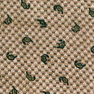 Loosely-woven gray ground with minute clusters of white dots in groups of three, and minute brown egg-shaped dots in groups of two. Block printed in small detached leaf pattern in green (blue with yellow) which is veined in brown. This leaf pattern about one inch long is in a diagonal and horizontal arrangement, but in random position.