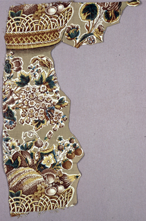 Fragment showing an incomplete repeat of a fruit basket and flowers. Background in light brown and pattern in shades of brown, yellow and green.