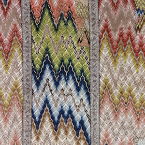 Panels of loosely woven linen canvas bound together by silver trimming, and solidly embroidered in bright polychrome silk floss in flame (brick, Florentine, bargello) sittch. Lined with old natural linen.