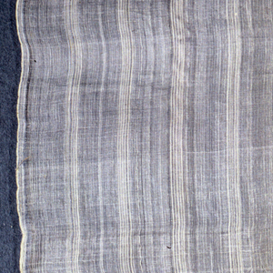 Length of white piña cloth, fine white stripes.