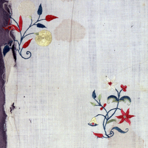 Fragment of cotton, embroidered in colored silks, showing floral sprays freely placed.