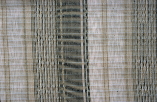 Large panel showing a design of horizontal stripes in black, gold, white and cream with metallic thread accents.