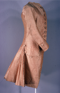 Man's coat of salmon pink silk brocade woven with a white lozenge grid pattern.  Each lozenge contains a small pink flower.