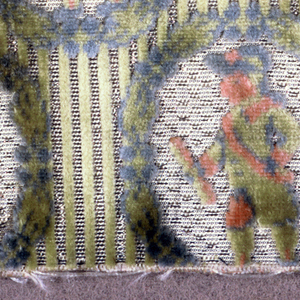 """Fragment of """"velours miniatures"""" with oval flower wreaths framing a uniformed man in profile. Background has thin green cut velvet stripes that alternate with off-white stripes shot with silver threads."""