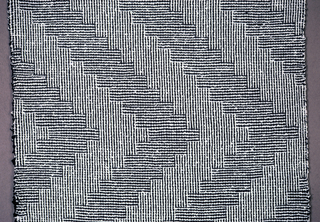 Square, fringed, in black and white, showing triangular zig-zag design