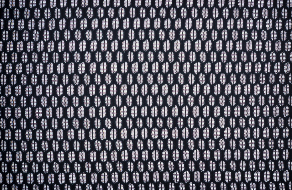 Length for upholstery, material in black and white cotton, nylon, shwoing honeycomb pattern