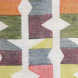 Length of hand block-printed linen in red, blue and yellow in geometric shapes.