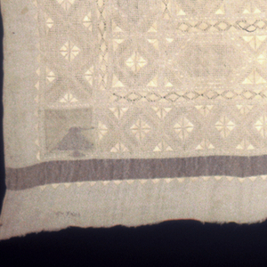 Foundation: plain weave with bands of metallic weft which have now oxidized to black and areas of supplementary metallic weft in each corner looking like squat birds with long beaks. There is a supplementary weft area in the middle of the cloth but it is hidden by subsequent embroidery. Embroidery: Deflected Element Work, Withdrawn Element Work with needle weaving and stem and satin stitches.