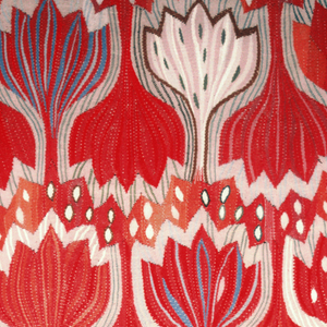 Hanging with a large-scale design of interlocking crocuses in bright red, violet, white, green, orange, gray and brown.