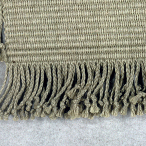 "Hanging called ""Cross"" in double weave in grey linen.  Fringed on all four sides."