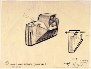 Three quarter back view of camera in center of sheet. Side view at right.