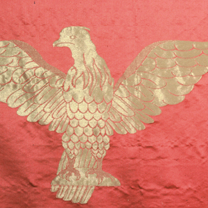 Large panel of red silk satin with pattern of large eagel in gold with flaming torch to its side, - a modified version of the Smithsonian's torch.