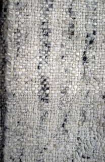 Jacket of Mexican handspun wool in a T-shaped form. Seamless and in the natural wool color.