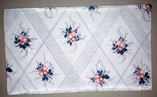 """Three pieces, same design, different colors. A) Ground printed, probably by """"molette,"""" in two shades of grey in minute zig-zags; darker shade forming trellis pattern. Small flower clusters in rose with green foliage and shadowy grey foliage, printed within trellis, probably by block. B) Same design but ground slightly blue-grey. C) Same design but ground in yellow. Glazed."""