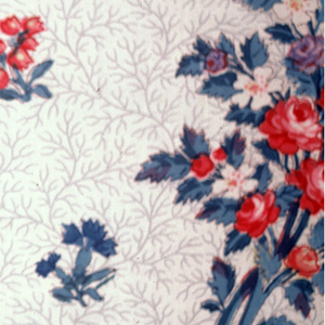 Ground molette-printed in grey with an all-over dotted tracery pattern. Over-printed with floral sprays and blossoms, all outlined in black, in red, blue, lavendar, blue-green and white.